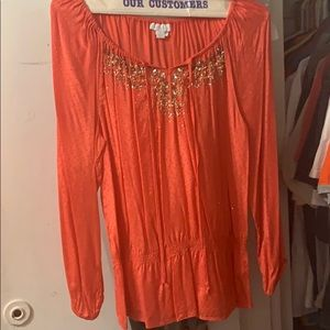 Beautiful orange tunic with some sparkling details